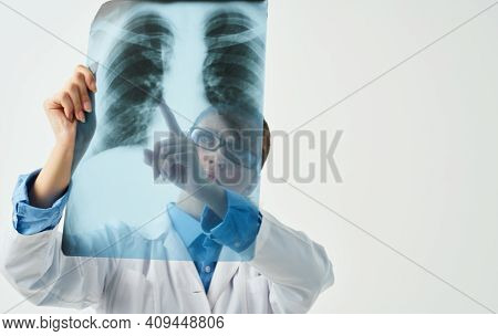 Chest X-ray And Female Doctor, Professional In His Field