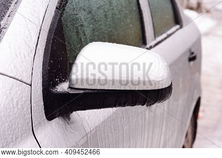 A Frozen Car Covered With Ice. How To De-ice The Frozen Car, Open A Frozen Shut Car Doors And Avoid