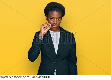 Young african american girl wearing business clothes mouth and lips shut as zip with fingers. secret and silent, taboo talking