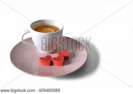 Cup Of Tea With Strawberry Chocolate On The Plate
