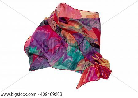 Silk Neckerchief Isolated. Closeup Of A Beautifully Wrapped Multicolored Silk Scarf Or Headscarf Wit