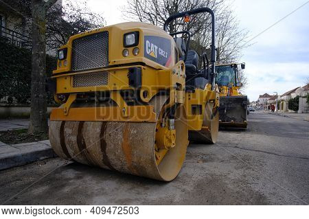 Bussy Saint Georges, France - February 20, 2021 : A Vibratory Double Drum Roller Parked On A Street