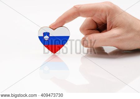 Slovenia Flag. Love And Respect Slovenia. A Man's Hand Holds A Heart In The Shape Of The Slovenia Fl