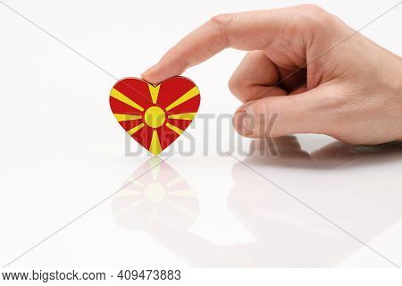 Flag Of Macedonia. Love And Respect Macedonia. A Man's Hand Holds A Heart In The Shape Of The Macedo