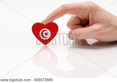 Tunisia Flag. Love And Respect Tunisia. A Man's Hand Holds A Heart In The Shape Of The Tunis Flag On