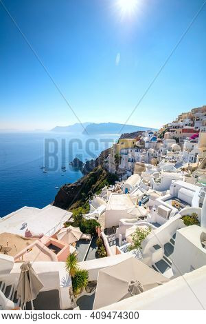 Vertical view of famous Oia, Santorini, Greece. A picturesque view of the traditional Santorini cycladic houses . Oia Village, Santorini, Greece.