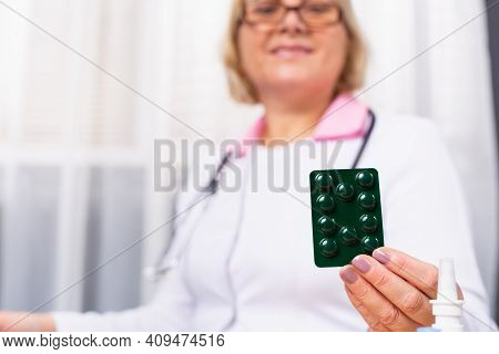 Pharmacist Or Doctor Hand Holding Pack Of Capsule Pills And Giving Patient Or People. Antibiotic Dru
