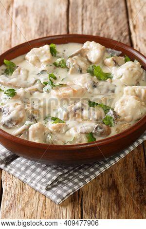 Romanian Creamed Chicken Ciulama De Pui Closeup In The Bowl On The Table. Vertical