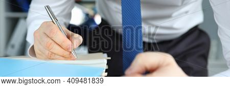 Man In Business Suit And Tie Number Stack Of Documents. Male Hand Lay On Paper And Write Number With