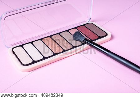 Eyeshadow Palette For Make Up On Pink Background With Copyspace. Rose Color Cosmetic Product With Ma
