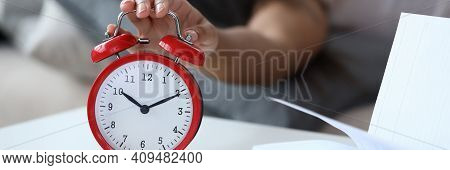 Woman Sleep In Bed. Man Want To Turn Off Alarm In Dream. Ringing Alarm Clock. On Table There Is Clos