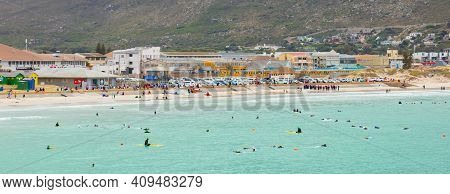 Cape Town, South Africa - February 21, 2021: Swimmers Frolicking In The Shallow Waves Of Fish Hoek B
