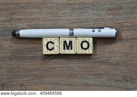 Pen And Square Letters With Text Cmo Stands For Chief Marketing Officer
