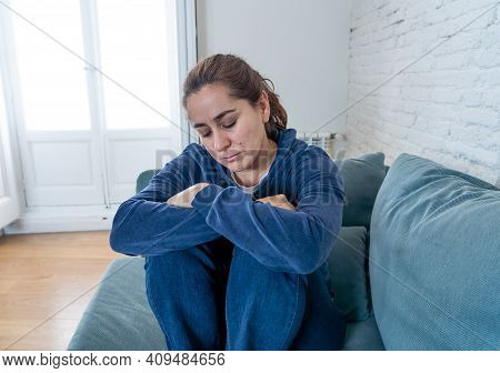 Young Sad Woman Suffering From Depression Feeling Lonely And Hopeless Isolated At Home