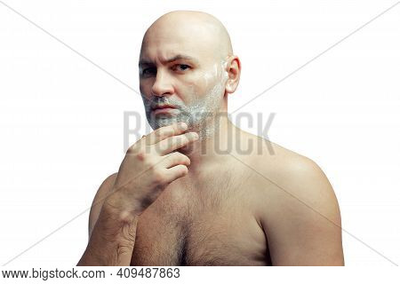 A Bald White Man Prepares To Shave His Stubble. A Mans Face With Shaving Foam. Portrait Isolated On
