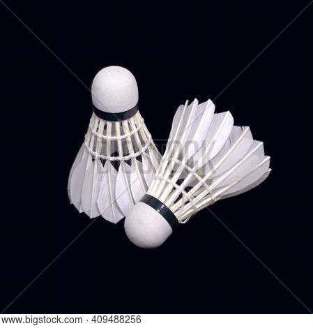 Two White Badminton Shuttlecocks From Synthetic Feathers Isolated On Black Background Indoor Studio