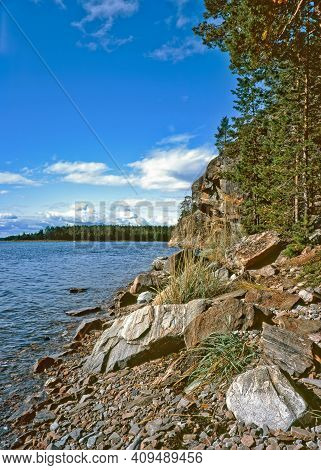 View Of The White Sea Coast Near The Arctic Circle.  There Are Stones Of Different Sizes And Shapes