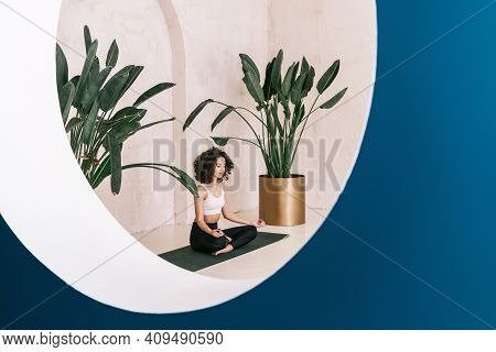 Peaceful And Tranquil African American Yogi In Deep Meditation Doing Breathing Exercise. Calm Woman