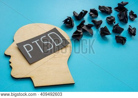 Head Shape And Word Ptsd Post Traumatic Stress Disorder With Black Paper Balls.