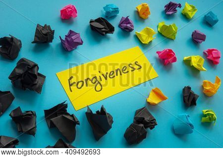 Forgiveness Word About Relationship And Color Paper Balls.