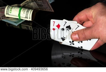 Poker Cards With Three Of A Kind Set Combination. Close Up Of A Gambler Hand Is Holding Playing Card