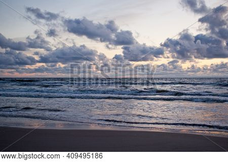 Evening Seascape With Clouds And Waves. Dramatic Seascape.