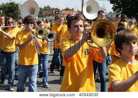 BROKEN ARROW, OK-MAY 14: Hundreds of unidentified school children from the Broken Arrow school district march in the Rooster Day Parade in Broken Arrow, OK on May 14, 2012
