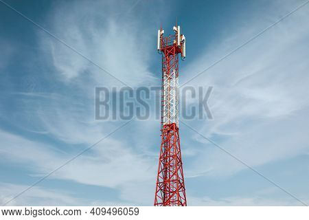 New Telecommunication Antenna On Background Of Blue Sky. Satellite Dish Telecom Network At Communica