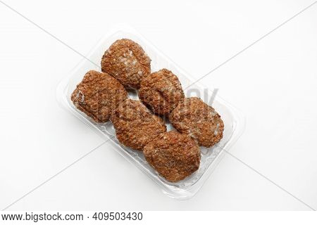 Top View Of Fried Meat Patties, Burgers On A Plastic, Transparent Food Tray, Isolated On White.