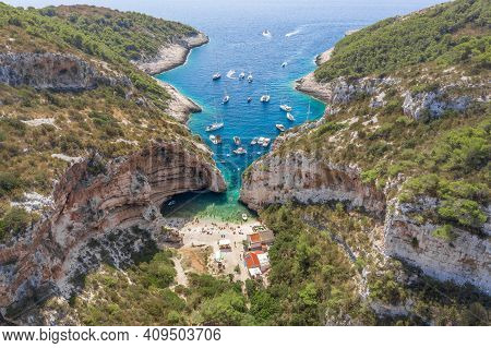 Aerial Drone Shot Of Iconic Stiniva Cove Beach Of Adriatic Sea On Vis Island In Croatia Summer