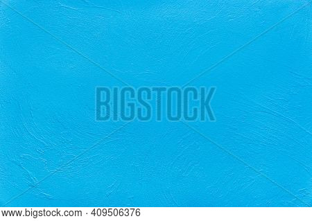 Light Clean Blue Plaster Wall Texture Stucco Background.