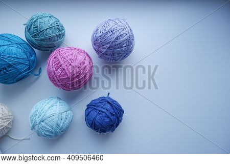 Balls Of Yarn On A White Background. Yarn Of Different Colors. The Concept Of Creating A Product. Cr
