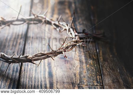 Christian Crown Of Thorns Like Christ Wore With Blood Drops Over A Rustic Wood Background Or Table.