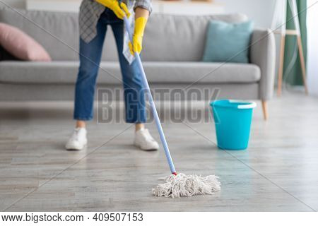 Cropped View Of Young Housewife Washing Floor With Mop At Home, Closeup Of Legs. Unrecognizable Woma