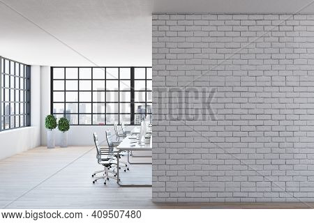 Light Brick Wall In Modern Open Space Office With Light Interior Design, Wooden Floor And Big Window