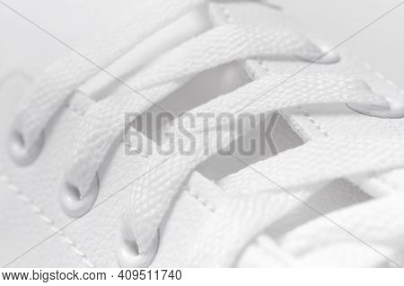 White Women's Leather Sneakers Close-up, Macro Photography. Stylish Youth Sneakers, Sports Shoes, Ge
