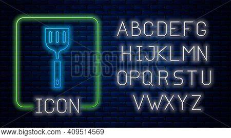 Glowing Neon Spatula Icon Isolated On Brick Wall Background. Kitchen Spatula Icon. Bbq Spatula Sign.