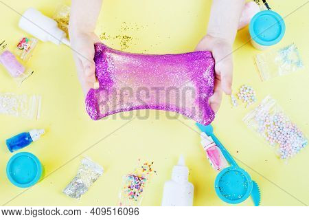 Making Slime At Home. Child Stretching Colorful Slime. Diy Concept. Hands Make Slime With Sequins On