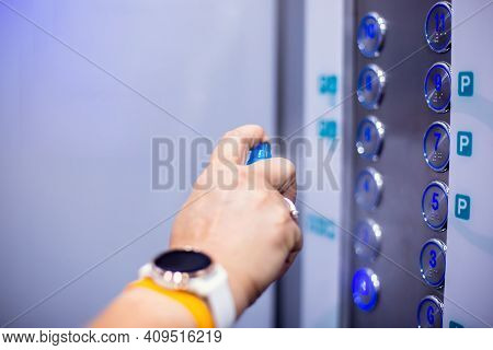 Selective Focus To Elevator Switch Button With Blur Hand Of Staff Cleaning It By Alcohol Spray In Ho
