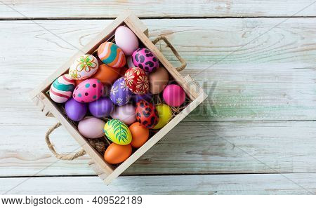 Easter Holiday Concept,colorful Easter Eggs In Basket On White Pastel Color Rustic Wood Background W
