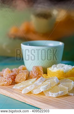Blue Teacup And Lemon Slices With Yellow Peel, Soft Focus Of Sugar Sweet Ginger. Blurred Vertical Ba