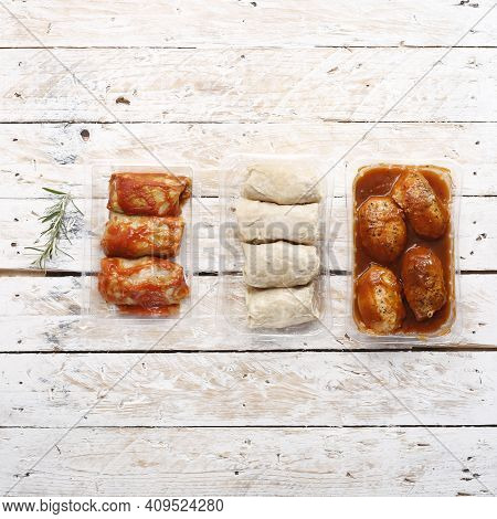 Delicatessen Goods. Cabbage Rolls And Meat Balls, Minced Cutlets In Food Trays, On Wood Boards, Top