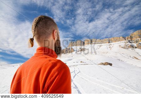 A Bearded Man With A Brutal Haircut In A Red Sweater Looks At The Epic Not Criminal Rocks On A Sunny