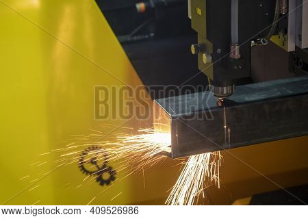 The Fiber Laser Cutting Machine Cutting The Square Stainless Steel Tube Control By Cnc Program. The