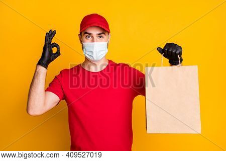 Portrait Of Nice Healthy Guy Wear Mask Bringing Cafe Order Showing Ok-sign Stop Pandemia Mers Cov Is