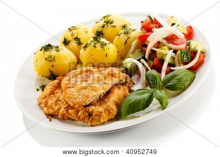 Pork chop, boiled potatoes and vegetables