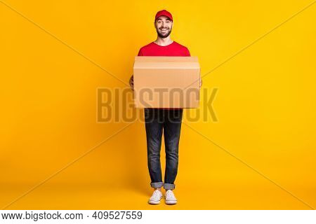 Full Length Body Size View Of Nice Cheerful Guy Mailman Holding In Hands Bringing Big Parcel Fast Sh