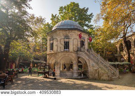 Bursa, Turkey - October 14, 2019: Tea gardens and silk shops in Koza Han Silk Bazaar. Koza Han is historical place from Ottoman times in Bursa, Turkey