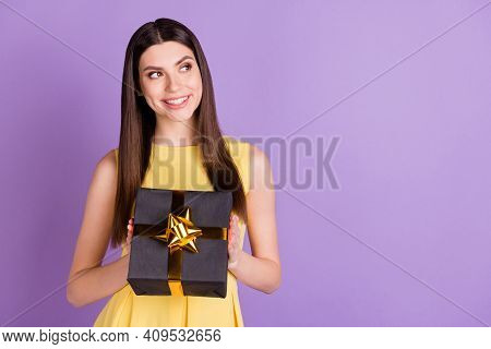 Portrait Of Charming Cheerful Girl Holding In Hand Giftbox Copy Space Ad Isolated Over Violet Purple