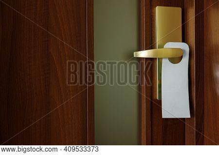 The Wooden Door Is Brown With A Digital Door Lock. The Electronic Door Handle Is Mounted On A Wooden